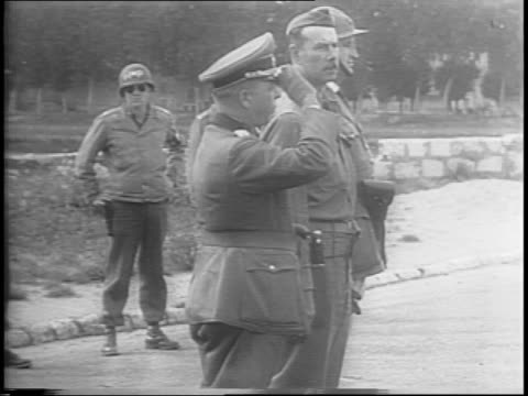 nazi major general erich elster surrendering to allied troops / turning over revolver / american soldier interpreting elster's surrender / surrender... - anno 1944 video stock e b–roll