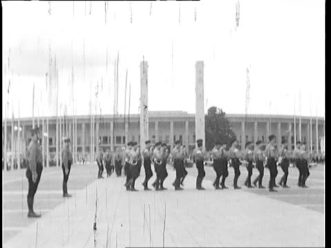 nazi marching band practice outside stadium national socialist activists practice marching formation - nazi germany stock videos and b-roll footage