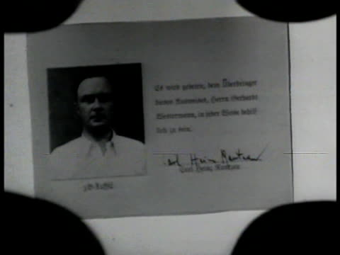 Nazi member 'Baumeyer' examining microfilm CU Microfilm of undercover FBI agent 'Miller' being German INT VS Miller serving food amp eating w/...