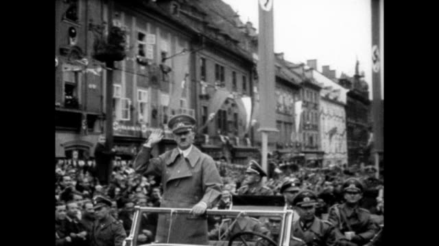 / Nazi motorcade through streets of the Sudetenland Czechoslovakia after the annexation of the territory into the German Reich / spectators salute as...