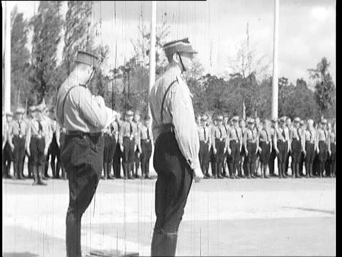 nazi officer gives handshakes to soldiers after speech soldiers stand still - nazi germany stock videos and b-roll footage