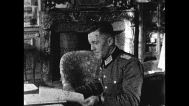 nazi officer rides in a car, smiles to the camera, sits down at desk to do paperwork in luxurious residence. - document stock videos & royalty-free footage