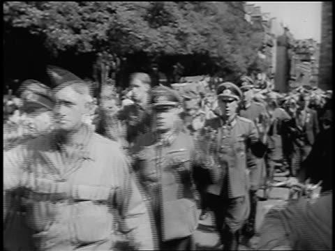 nazi officers raising hands in surrender + marching in streets / paris / documentary - deutsches militär stock-videos und b-roll-filmmaterial
