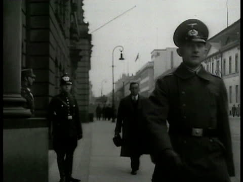 nazi officers walking down street saluting other officers cu german sign 'bureau of war psych' int staff in office analyzing photos against light cu... - anno 1938 video stock e b–roll