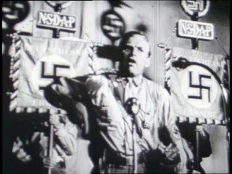 a nazi official speaks to an excited crowd; a hand holds a billy club and shoots a gun. - nazi swastika stock videos & royalty-free footage