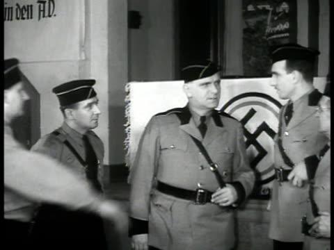 nazi rally convention us flags. vs leader fritz kuhn talking w/ officers. nazi swastika & us flags marching in rally. stormtroopers standing nazi... - 1939 bildbanksvideor och videomaterial från bakom kulisserna