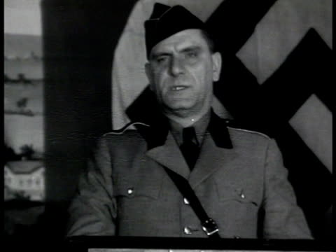 stockvideo's en b-roll-footage met nazi rally in madison square garden new york. leader fritz kuhn talking nazi salute . xws crowds in rally cheering . wwii - nazism
