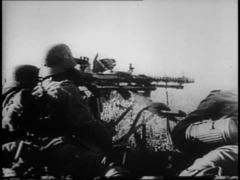 nazi soldiers fire on russian town, hit a smokestack / infantry moves into town, armed with machine guns / nazi soldier bring propaganda machine to... - 1941 bildbanksvideor och videomaterial från bakom kulisserna