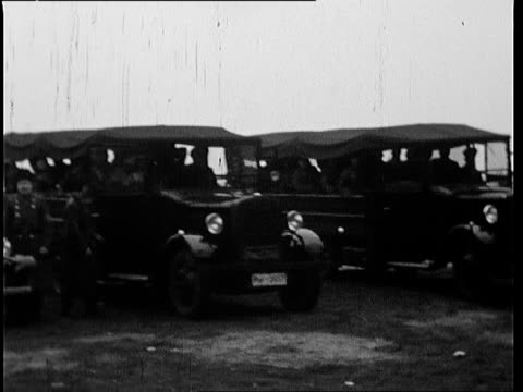 nazi soldiers in winter coats get out of cars/trucks and line up in a forrest - trucks in a row stock videos & royalty-free footage