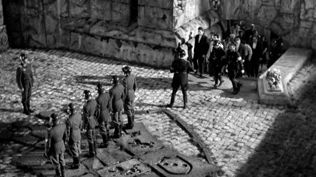 nazi soldiers lead hostages up a fortress stairway and toward a courtyard in front of a firing squad. - civilian stock videos & royalty-free footage