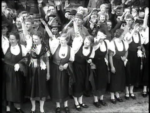 nazi soldiers march through a european town. - tschechische republik stock-videos und b-roll-filmmaterial