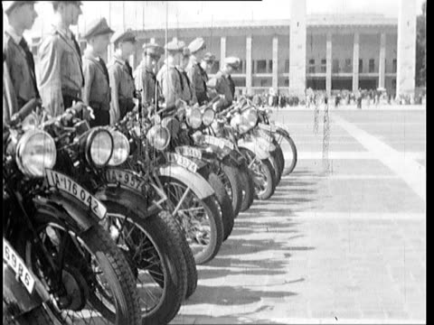 nazi soldiers practicing marching fomations motorcycles and flags medium closeups of superior officers talking - nur junge männer stock-videos und b-roll-filmmaterial