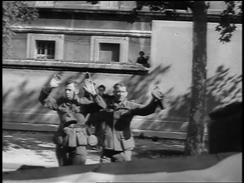 nazi soldiers raising hands in surrender + walking towards camera / paris / documentary - deutsches militär stock-videos und b-roll-filmmaterial