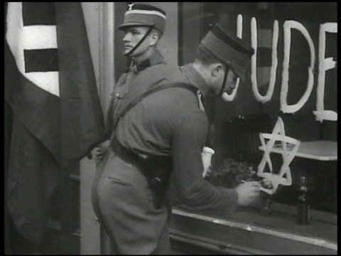 dramatization nazi soldiers rousting office workers nazi soldier painting star of david below 'juden' on shop window nazi soldiers fighting owners in... - ナチズム点の映像素材/bロール