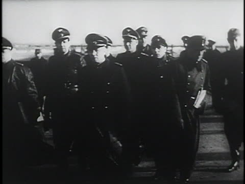 nazi soldiers stand at attention as nazi general rommel and other nazi officers walk by them. - nazism video stock e b–roll