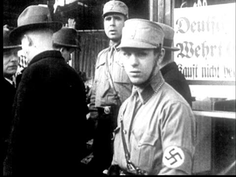 1942 ms pan nazi soldiers standing in front of shop with sign saying don't buy from jews - prelinger archive stock-videos und b-roll-filmmaterial
