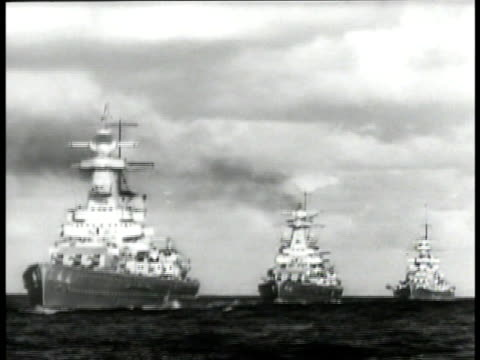 nazi swastika flag on german ship. line of german destroyer ships at sea. battleship guns. convoy of cruisers at sea. wwii world war ii - nazi swastika stock videos & royalty-free footage