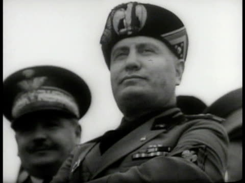 nazi swastika flags la ext cu italy prime minister benito mussolini standing ws crowd cheering italy ms adolf hitler w/ aides smiling germany... - benito mussolini stock videos & royalty-free footage