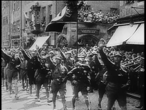 nazi troops giving fascist salute marching at rally at nuremberg / newsreel - 1920 1929 stock videos & royalty-free footage