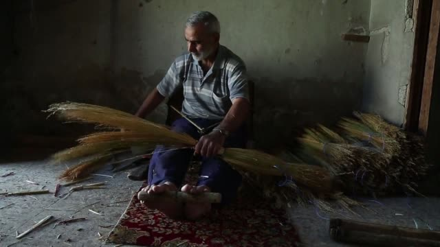 nazir one of the last craftsman of his kind has been making straw brooms by hand in rebel held eastern ghouta near damascus for 25 years - craft stock videos and b-roll footage