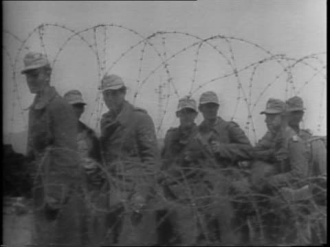 nazis are captured by allied troops, including 16 generals / montage of german prisoners and officers with suitcases, playing cards, behind barbed... - allied forces stock videos & royalty-free footage