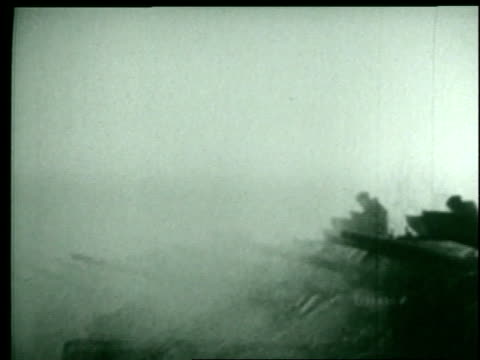 nazis fight against the allies in the snow as tanks roll and explosions blast the fields. - ardennenoffensive stock-videos und b-roll-filmmaterial