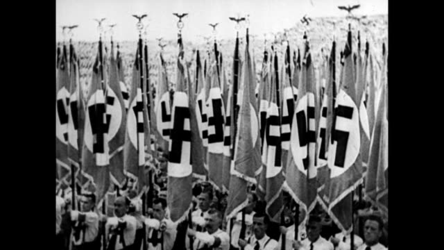 vídeos de stock e filmes b-roll de nazis holding flags / cheering fascist crowds in italy / superimposed image of hirohito hitler and mussolini over cheering crowds montage of wwii... - 1939