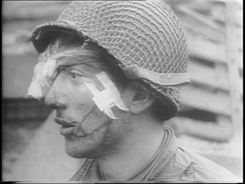 nazis in cherbourg are rounded up by us troops / us soldier reminds a german to hold his hands above his head / us soldiers pat down captured germans... - surrendering stock videos & royalty-free footage