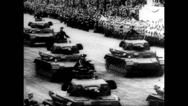 vídeos de stock e filmes b-roll de nazis increase arms production / warships nazi soldiers riding in tanks parade of tanks down street airplanes / japanese munitions plant production /... - 1939