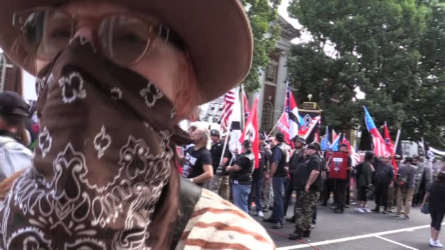nazis march yelling 'off our streets commie scum' pepper spray us and start punching while cops stand down - confederate flag stock videos & royalty-free footage