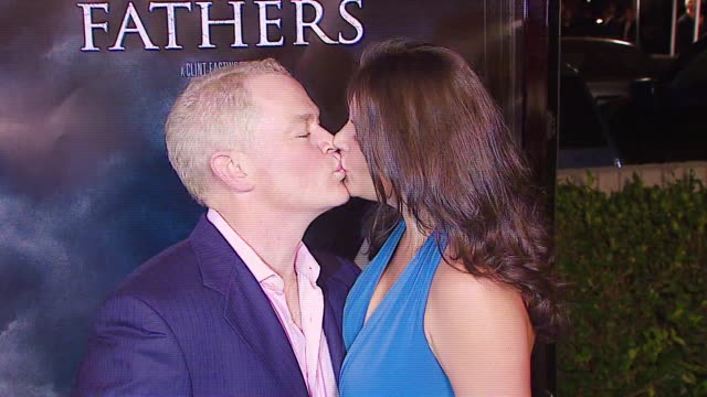 vídeos de stock, filmes e b-roll de neal mcdonoughright and wife ruve robertson at the 'flags of our fathers' los angeles premiere at academy of motion picture arts sciences in los... - academy of motion picture arts and sciences