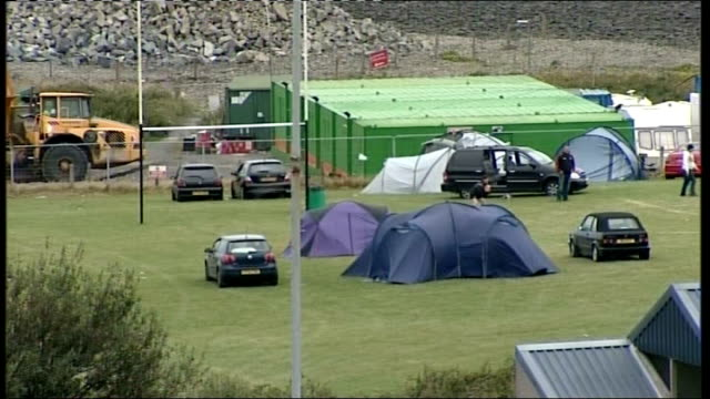 near aberystwyth aberaeron rugby club ext shots of rugby pitch tents in field clubhouse sign at roadside for 'festival of rugby' - aberystwyth stock videos & royalty-free footage