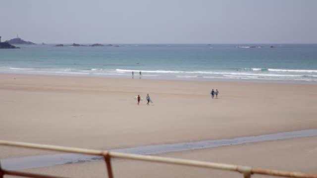 near empty beach in guernsey during coronavirus lockdown - channel islands england stock videos & royalty-free footage
