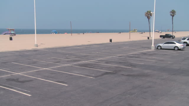 WS A near empty parking lot adjacent to a vacant beach / California, United States