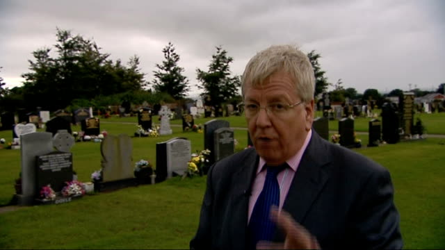 near glasgow lenzie ext tracking shot past graves in cemetery various of ages inscribed/engraved on gravestones reporter to camera glasgow reporter... - lager stock videos & royalty-free footage