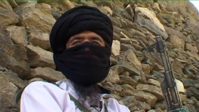 Taliban commander loading bullets into machine gun clip Taliban commander interview SOT we are fighting the foreigners and we will not stop Taliban...