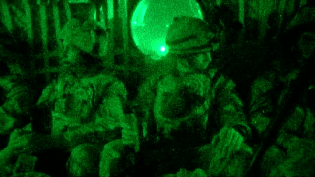 vision *** views from open chinook helicopter door in flight soldier looking out other helicopters behind black watch troops during flight ends... - night vision stock videos and b-roll footage