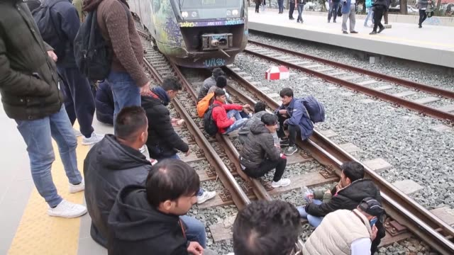 stockvideo's en b-roll-footage met nearly 200 migrants sit on railline at larissis station to block train services between athensthessalloniki near capital athens in greece on april 05... - athene griekenland