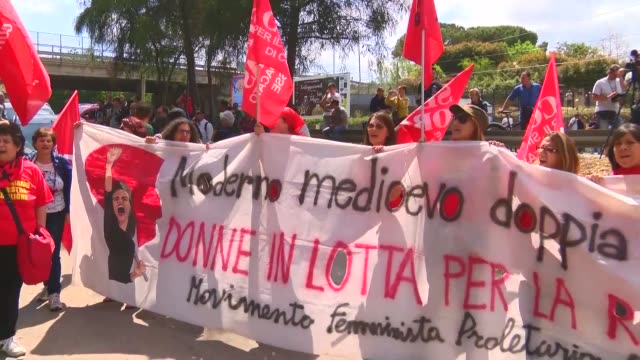 Nearly 2000 protesters march under high security at Giardini Naxos at the foot of the Taormina hill in Sicily where the G7 summit is taking place