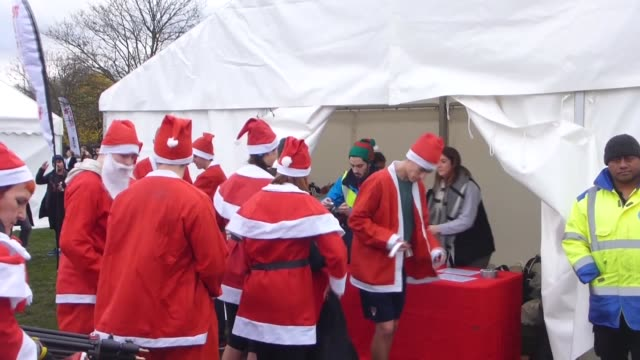 nearly 2000 thousand people including children in santa claus costumes run in 5 and 10kilometres long marathon at victoria park in eastern london in... - victoria park london stock videos & royalty-free footage