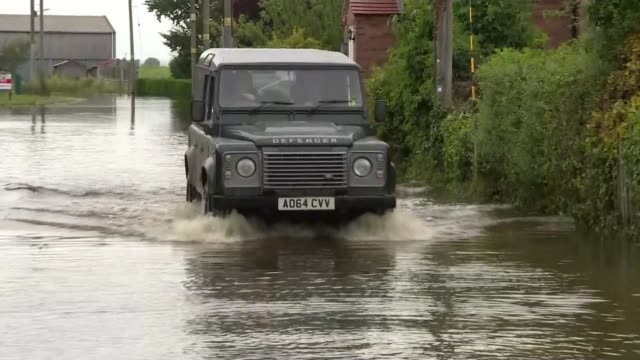 nearly 600 homes evacuated after flooding in lincolnshire england lincolnshire ext flood waters and houses jeep driving through flood water river... - driving stock videos & royalty-free footage