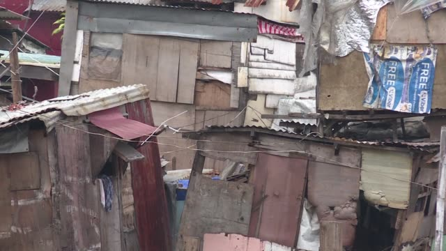 Nearly a quarter of Manila's 13 million residents live in slums due to poverty and a shortage of low cost housing studies have found