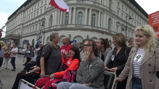 nearly a thousand people including those with physical disabilities marched from the presidential palace to the polish parliament on may 23 2019 in... - disability benefits stock videos & royalty-free footage