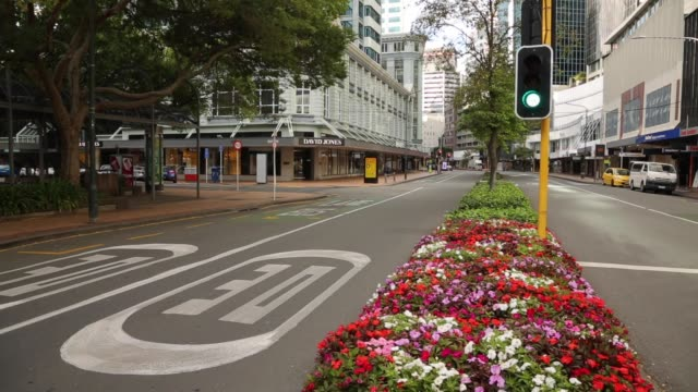 nearly deserted streets during the first day of a nationwide lockdown on march 26 2020 in wellington new zealand new zealand has gone into lockdown... - urban road stock videos & royalty-free footage