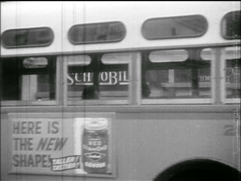 PAN nearly empty bus stopping on street in front of camera / Montgomery Bus Boycott AL