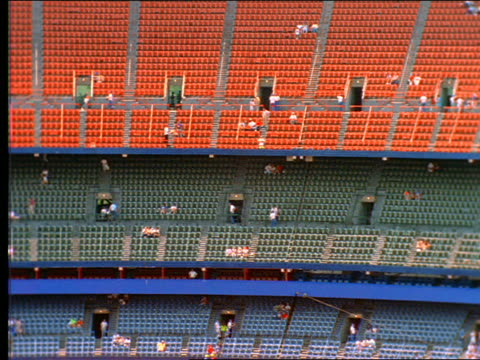 pan of nearly empty seats in shea stadium / queens, ny - shea stadium stock videos and b-roll footage