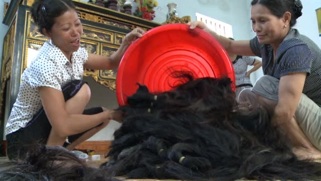 nearly every family in binh an village in northern vietnam is in some way involved in the lucrative hair industry voiced business booming on october... - danang stock videos & royalty-free footage