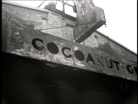 nearly five hundred people are killed in a fire in the coconut grove nightclub - grove stock videos & royalty-free footage