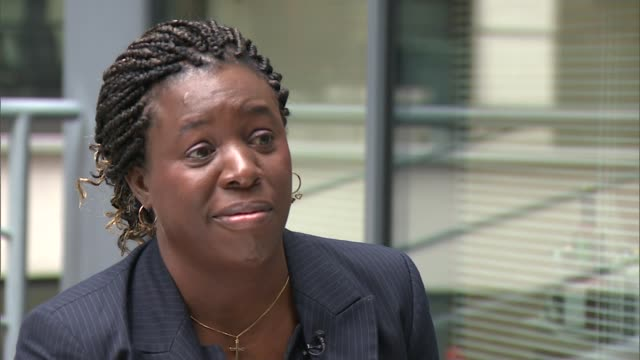 nearly half of minority employees say they have seen racism in the workplace; england: london: int christine danniell interview sot ext speeded up... - lambeth stock videos & royalty-free footage