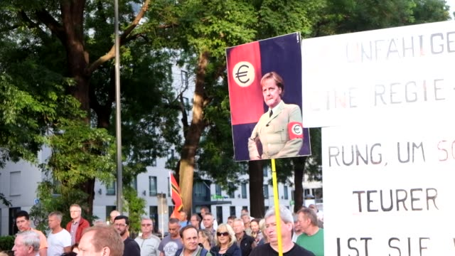 nearly one thousand people march in dresden, germany during an anti-immigration and anti-islamism rally organized by the patriotic europeans against... - saxony stock videos & royalty-free footage